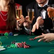 Gamblers drinking champagne — Stock Photo #39535683