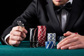 Casino gambler with chips — Stock Photo