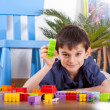 Stock Photo: Small boy playing blocks