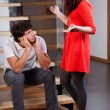 Woman standing by husband and moaning — Stock Photo