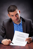 Crook holding an agreement — Stock Photo