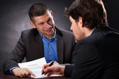 Naive man signing the usury contract — Stock Photo