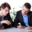 Men reading a contract before signing — Stock Photo
