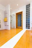 Big orange bathroom with heater — Stock Photo