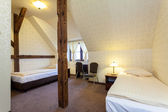 Big warm hotel bedroom — Stok fotoğraf