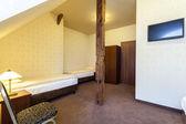 Classic hotel bedroom — Stok fotoğraf