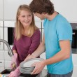Happy couple in kitchen — Stock Photo