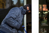 Housebreaker during entering to house — Stock Photo