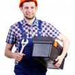 Handyman with wrench and toolbox — Stock Photo