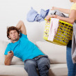 Woman cleaning man chilling — Stock Photo