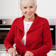 Smiled woman preparing meal — Stock Photo