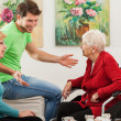 Young man tallking with two older women — Stock Photo #40739041
