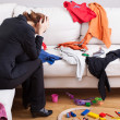 Unhappy woman in mess — Stock Photo #40739621