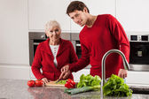 Grandmother with grandson in kitchen — Stock Photo