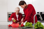 Grandson helping in kitchen — Stock Photo