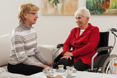Conversation of elderly women — Stock Photo