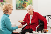 Disabled lady talking with her friend — Stock Photo