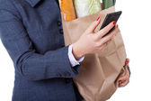 Shopping bag and smartphone — Photo