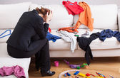 Unhappy woman in mess — Stock Photo