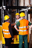 Forklift worker with management — Stock Photo
