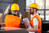 Two factory engineers discussing — Stock Photo