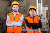 Happy employees in warehouse — Stock Photo