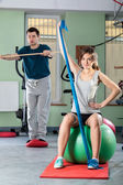 People in fitness center — Stock Photo