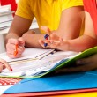 Group of students studying from notes — Stock Photo