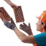 Builder taking bricks — Stock Photo #41436029