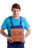 Man holding the  bricks — Stock Photo