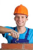 Happy bricklayer working — Stock Photo