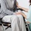 Stock Photo: Nurse supporting patient