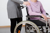 Daughter and her mom on wheelchair — Stock Photo