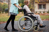 Caregiver and elder woman — Stock Photo