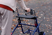 Woman with walker — Stock Photo