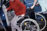 Nurse offering a wheelchair — Stock Photo