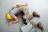 Unconscious handyman on the floor — Stock Photo