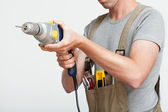 Handyman with drill — Stock Photo