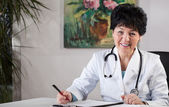 Doctor in office — Stock Photo