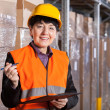 Manager in warehouse — Stock Photo