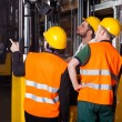 Worker on forklift in warehouse — Stock Photo #41588539