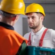 Worker consulting with manager in factory — Stock Photo