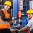 Production worker at workplace and supervisor — Stock Photo #41588829