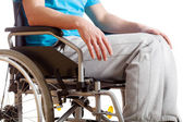 Sitting on wheelchair — Stock Photo