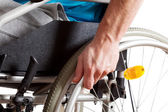 Wheelchair and hand closeup — Stock Photo
