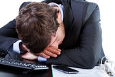 Businessman sleeping on his desk — Stock Photo