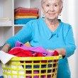 Elderdly lady with washing — Stock Photo