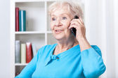 Senior woman talking on mobile phone — Stock Photo