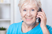 Senior lady talking on cellular phone — Stock Photo