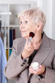 Elderly woman making up — Stock Photo